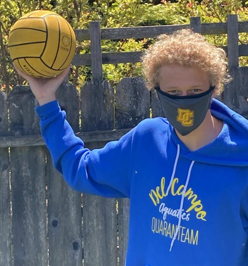 "Freshman Water Polo player, Brendan Helton shows off his ""Quarenteam"" sweatshirt and the newest DC accessory...a cool mask!"