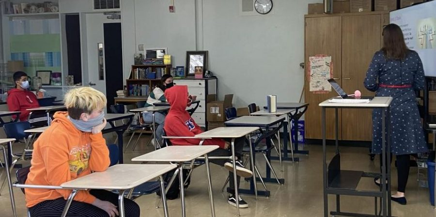 Mrs. Pfarr teaches a socially distant Freshmen Research Expo class during third period.